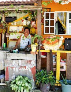 Woman washing a pot - Manzanillo Sun eMagazine